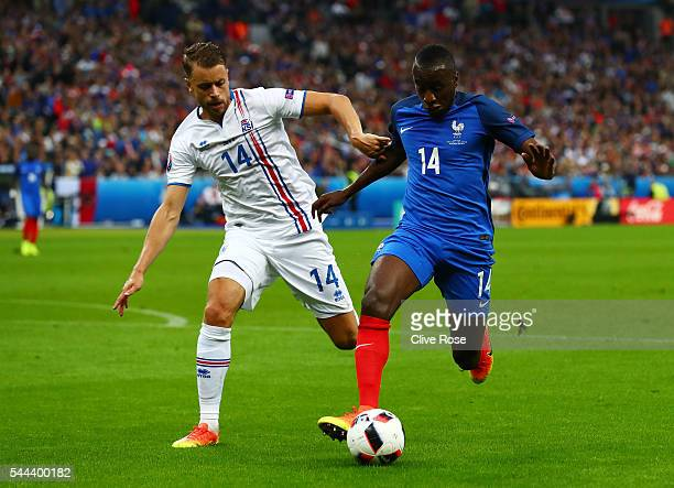 Blaise Matuidi of France and Kari Arnason of Iceland compete for the ball during the UEFA EURO 2016 quarter final match between France and Iceland at...