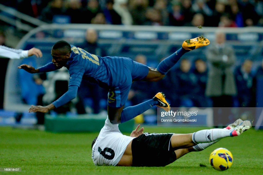 <a gi-track='captionPersonalityLinkClicked' href=/galleries/search?phrase=Blaise+Matuidi&family=editorial&specificpeople=801779 ng-click='$event.stopPropagation()'>Blaise Matuidi</a> of France is challenged by <a gi-track='captionPersonalityLinkClicked' href=/galleries/search?phrase=Sami+Khedira&family=editorial&specificpeople=2513712 ng-click='$event.stopPropagation()'>Sami Khedira</a> of Germany during the international friendly match between France and Germany at Stade de France on February 6, 2013 in Paris, France.