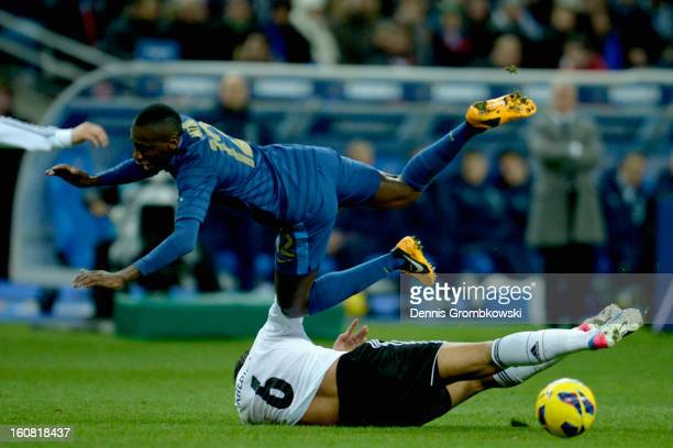 Blaise Matuidi of France is challenged by Sami Khedira of Germany during the international friendly match between France and Germany at Stade de...