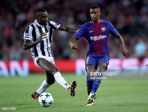Blaise Matuidi of Juventus and Nelson Semedo of Barcelona battle for possession during the UEFA Champions League Group D match between FC Barcelona...