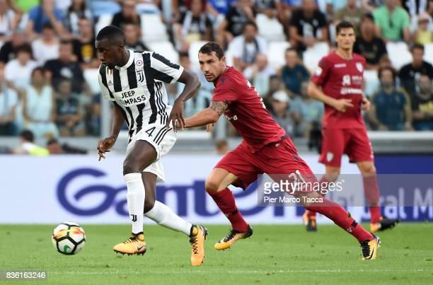 Blaise Matuidi of Juventus competes for the ball with Artur Ionita of Cagliari Calcio during the Serie A match between Juventus and Cagliari Calcio...