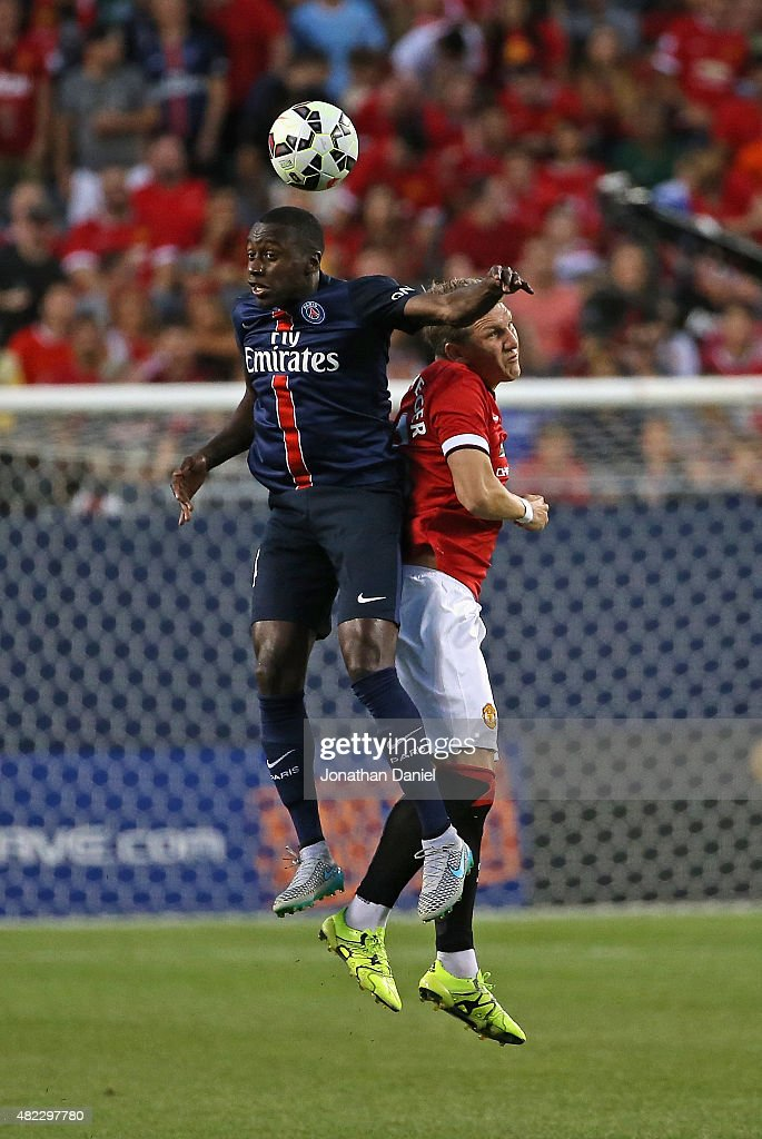 Blaise Matuidi #14 of Paris Saint-Germain and Bastian Schweinsteiger #23 of Manchester United battle for a header during a match in the 2015 International Champions Cup at Soldier Field on July 29, 2015 in Chicago, Illinois.