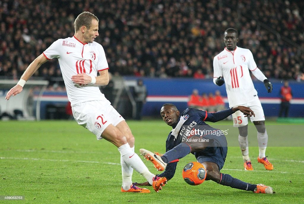 <a gi-track='captionPersonalityLinkClicked' href=/galleries/search?phrase=Blaise+Matuidi&family=editorial&specificpeople=801779 ng-click='$event.stopPropagation()'>Blaise Matuidi</a> of Paris Saint-Germain and <a gi-track='captionPersonalityLinkClicked' href=/galleries/search?phrase=David+Rozehnal&family=editorial&specificpeople=546591 ng-click='$event.stopPropagation()'>David Rozehnal</a> of Lille LOSC during the French Ligue 1 between Paris Saint-Germain FC and LOSC Lille FC at Parc Des Princes on december 22, 2013 in Paris, France.