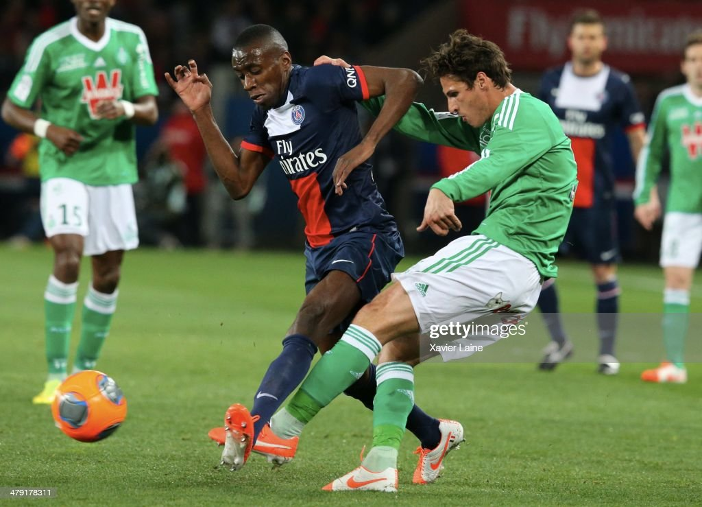 <a gi-track='captionPersonalityLinkClicked' href=/galleries/search?phrase=Blaise+Matuidi&family=editorial&specificpeople=801779 ng-click='$event.stopPropagation()'>Blaise Matuidi</a> of Paris Saint-Germain and Jeremy Clement of AS Saint-Etienne during the French Ligue 1 match between Paris Saint-Germain FC and AS Saint-Etienne at Parc Des Princes on March 16, 2014 in Paris, France.