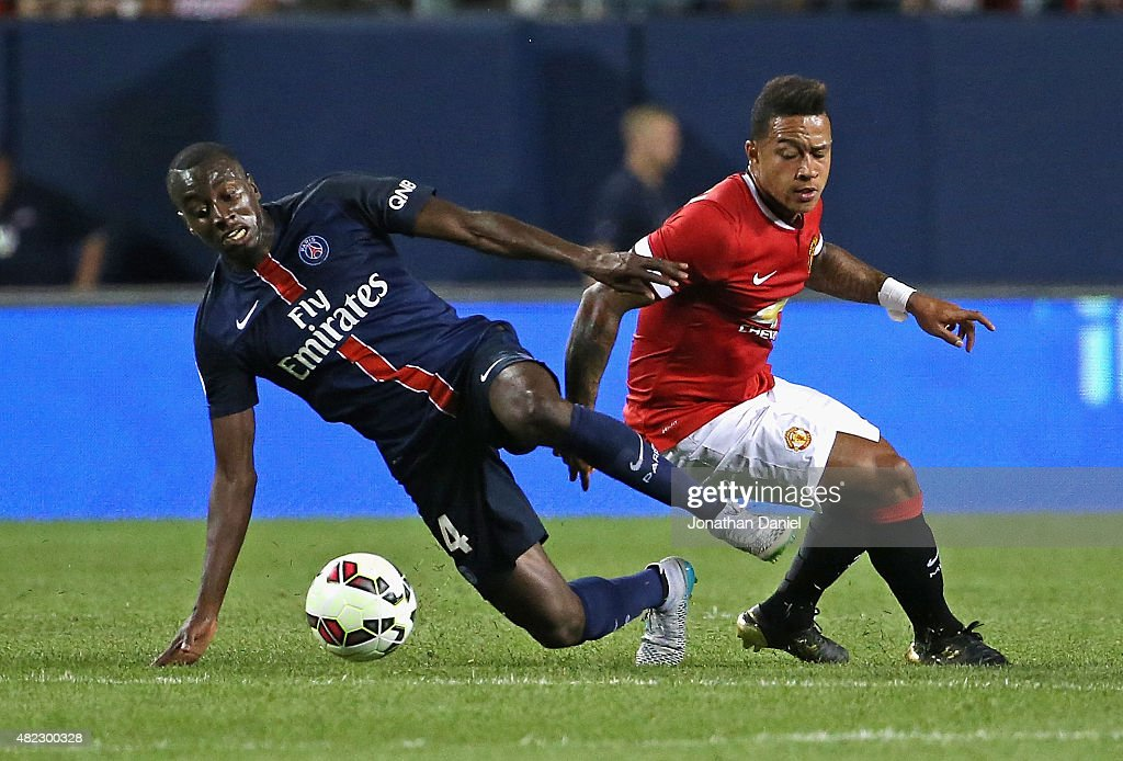 Blaise Matuidi #14 of Paris Saint-Germain and Memphis DePay #9 of Manchester United battle for the ball during a match in the 2015 International Champions Cup at Soldier Field on July 29, 2015 in Chicago, Illinois.