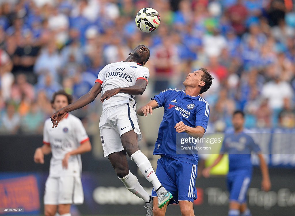Blaise Matuidi #14 of Paris Saint-Germain battles Nemanja Matic #21 of Chelsea for a header during their International Champions Cup match at Bank of America Stadium on July 25, 2015 in Charlotte, North Carolina. Chelsea won 2-1 on penalty kicks.