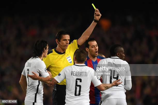Blaise Matuidi of Paris SaintGermain is shown an yellow card by referee Deniz Aytekin during the UEFA Champions League Round of 16 second leg match...