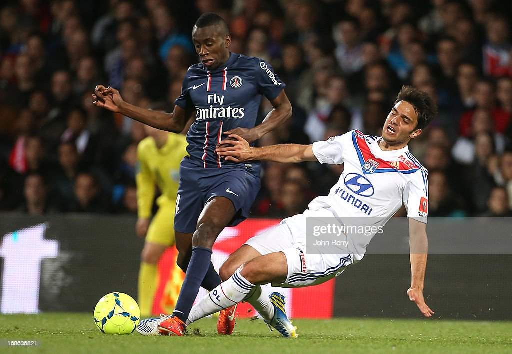 <a gi-track='captionPersonalityLinkClicked' href=/galleries/search?phrase=Blaise+Matuidi&family=editorial&specificpeople=801779 ng-click='$event.stopPropagation()'>Blaise Matuidi</a> of PSG and <a gi-track='captionPersonalityLinkClicked' href=/galleries/search?phrase=Clement+Grenier&family=editorial&specificpeople=5774493 ng-click='$event.stopPropagation()'>Clement Grenier</a> of Lyon in action during the Ligue 1 match between Olympique Lyonnais, OL, and Paris Saint-Germain FC, PSG, at the Stade Gerland on May 12, 2013 in Lyon, France.
