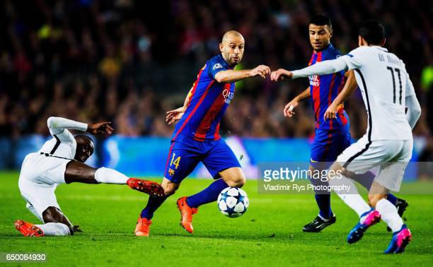 Blaise Matuidi of PSG and Javier Mascherano of Barcelona battle for the ball during the UEFA Champions League Round of 16 second leg match between FC...
