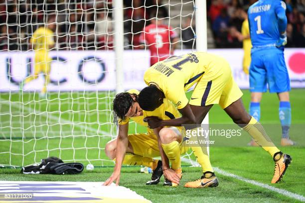 Blaise Matuidi of PSG checks on teammate Edinson Cavani of PSG who goes down injured at the end of the match during the Ligue 1 match between EA...