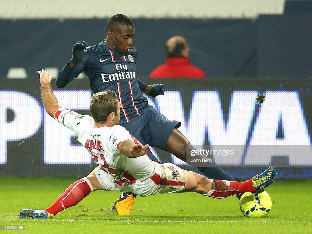 Blaise Matuidi of PSG tries to go past Jean-Baptiste Pierazzi of AC Ajaccio during the French Ligue 1 match between Paris Saint Germain FC and AC Ajaccio at the Parc des Princes stadium on January 11, 2013 in Paris, France.