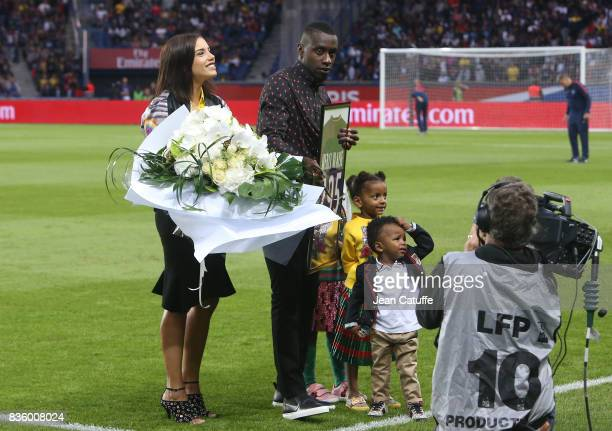 Blaise Matuidi who just left PSG for Juventus Turin here with his wife Isabelle Matuidi and kids is honored before the French Ligue 1 match between...