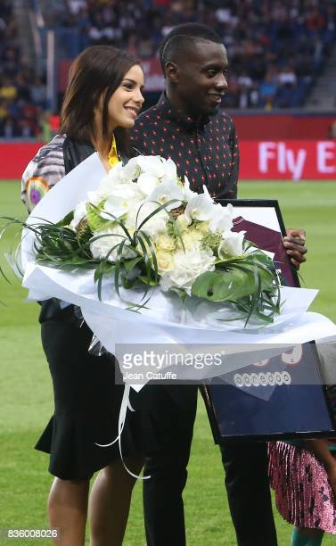 Blaise Matuidi who just left PSG for Juventus Turin here with his wife Isabelle Matuidi is honored before the French Ligue 1 match between Paris...