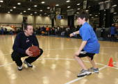 Blake Ahearn of the Bakersfield Jam encourages a participant during the Gatorade basketball clinic during Jam Session presented by Adidas during All...