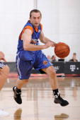 Blake Ahearn of the New York Knicks drives against the Detroit Pistons during NBA Summer League presented by EA Sports on July 15 2009 at Cox...