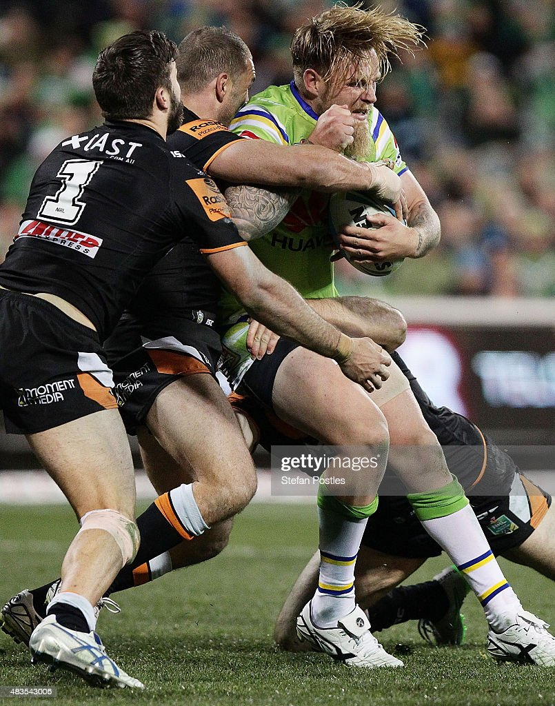Blake Austin of the Raiders is tackled during the round 22 NRL match between the Canberra Raiders and the Wests Tigers at GIO Stadium on August 10, 2015 in Canberra, Australia.