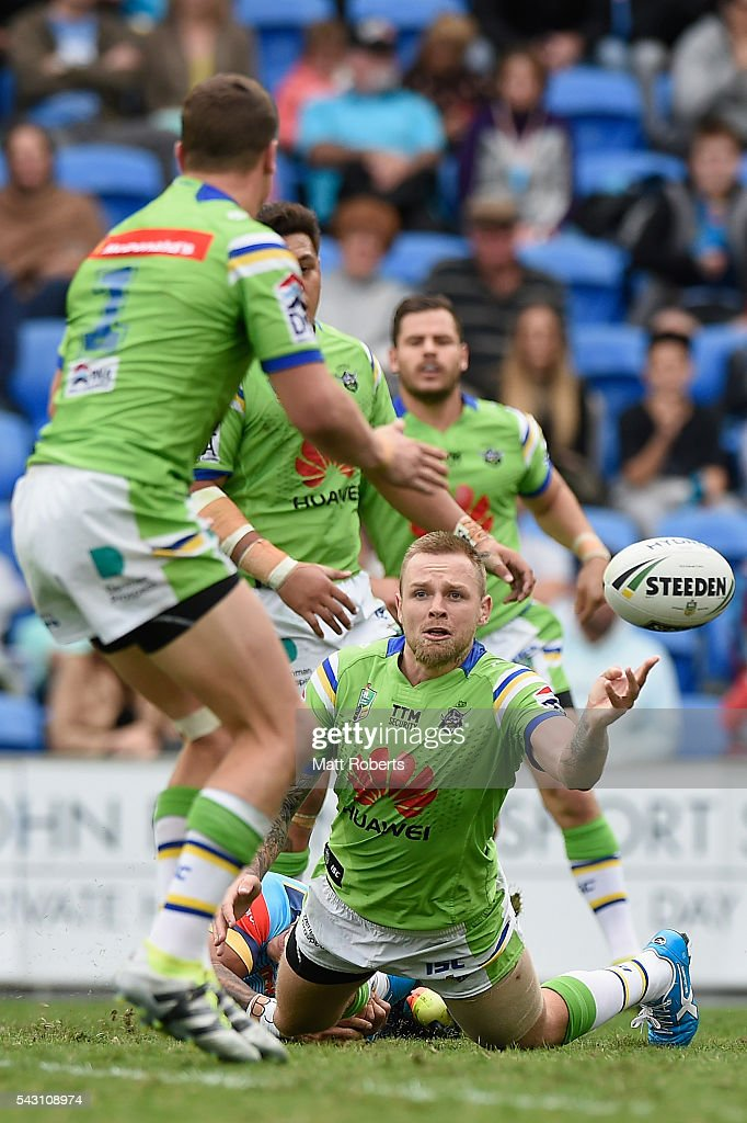 Blake Austin of the Raiders offloads during the round 16 NRL match between the Gold Coast Titans and the Canberra Raiders at Cbus Super Stadium on June 26, 2016 in Gold Coast, Australia.