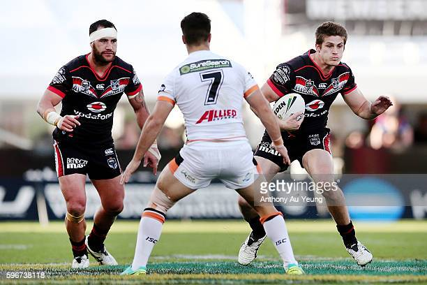 Blake Ayshford and Bodene Thompson of the Warriors run at Luke Brooks of the Tigers during the round 25 NRL match between the New Zealand Warriors...
