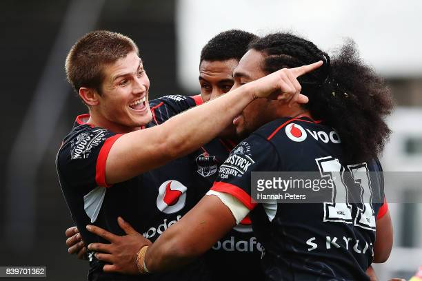 Blake Ayshford celebrates with David Fusitu'a of the Warriors after his try during the round 25 NRL match between the New Zealand Warriors and the...