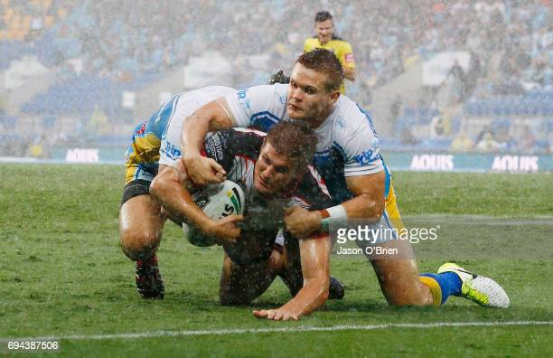 Blake Ayshford of the Warriors breaks the defence to score a try during the round 14 NRL match between the Gold Coast Titans and the New Zealand...