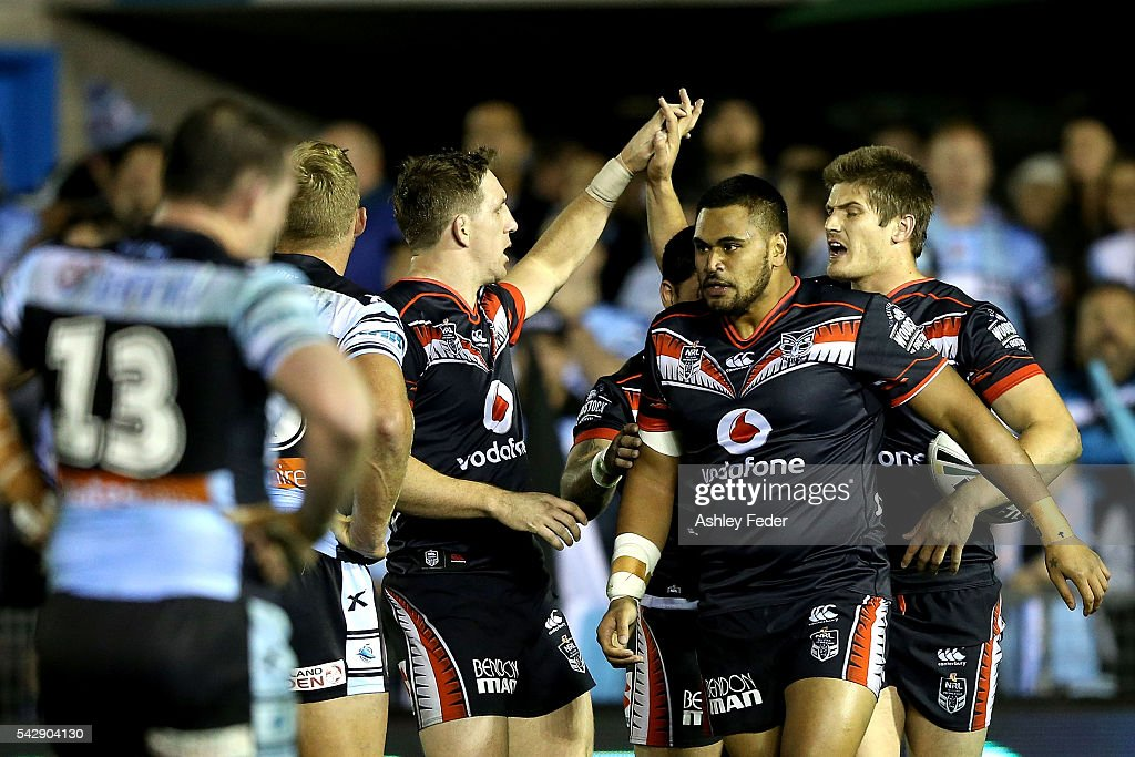 Blake Ayshford of the Warriors celebrates a try with team mates during the round 16 NRL match between the Cronulla Sharks and the New Zealand Warriors at Southern Cross Group Stadium on June 25, 2016 in Sydney, Australia.