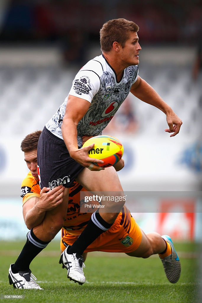 Blake Ayshford of the Warriors is tackled during the 2016 Auckland Nines match between the New Zealand Warriors and the Brisbane Broncos at Eden Park on February 7, 2016 in Auckland, New Zealand.