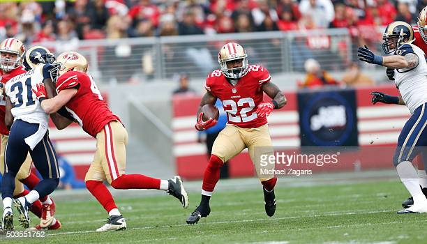 Blake Bell and Bruce Miller of the San Francisco 49ers block as Mike Davis rushes during the game against the St Louis Rams at Levi Stadium on...