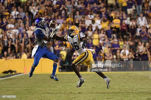 Blake Bone of the Kentucky Wildcats catches a pass in front of Tre'Davious White of the LSU Tigers during the second quarter of a game at Tiger...