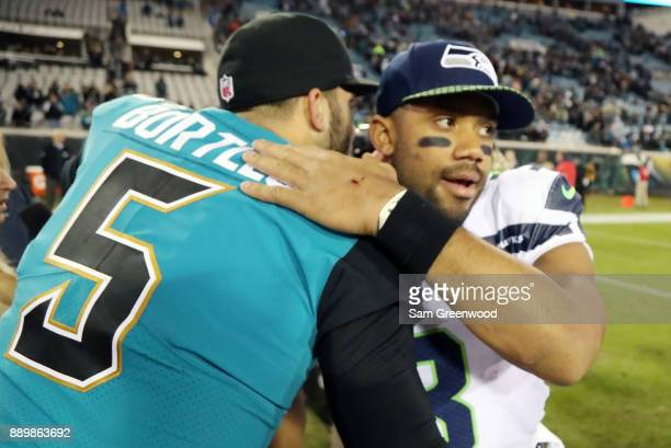 Blake Bortles of the Jacksonville Jaguars greets Russell Wilson of the Seattle Seahawks after the Jaguars defeated the Seahawks 3024 at EverBank...