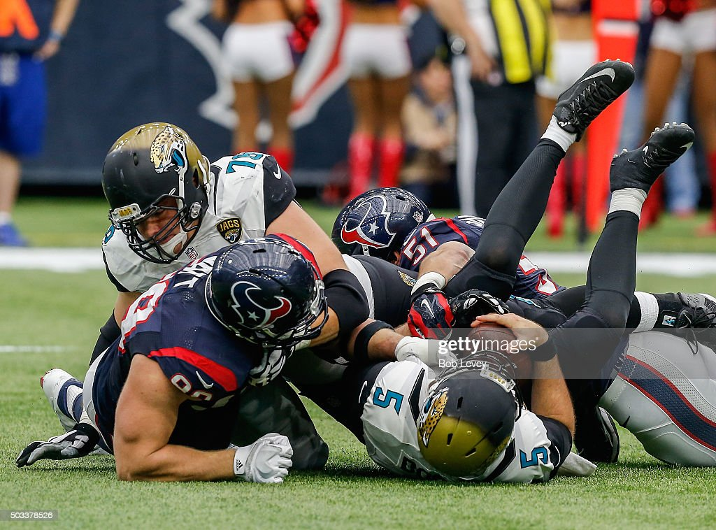 <a gi-track='captionPersonalityLinkClicked' href=/galleries/search?phrase=Blake+Bortles&family=editorial&specificpeople=9706465 ng-click='$event.stopPropagation()'>Blake Bortles</a> #5 of the Jacksonville Jaguars is sacked by <a gi-track='captionPersonalityLinkClicked' href=/galleries/search?phrase=J.J.+Watt&family=editorial&specificpeople=6243554 ng-click='$event.stopPropagation()'>J.J. Watt</a> #99 of the Houston Texans along with <a gi-track='captionPersonalityLinkClicked' href=/galleries/search?phrase=John+Simon+-+American+Football+Linebacker&family=editorial&specificpeople=11338141 ng-click='$event.stopPropagation()'>John Simon</a> #51 and Whitney Mercilus #59 as <a gi-track='captionPersonalityLinkClicked' href=/galleries/search?phrase=Luke+Joeckel&family=editorial&specificpeople=7415529 ng-click='$event.stopPropagation()'>Luke Joeckel</a> #76 of the Jacksonville Jaguars attempts to block at NRG Stadium on January 3, 2016 in Houston, Texas.