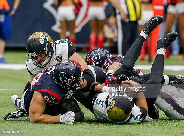 Blake Bortles of the Jacksonville Jaguars is sacked by JJ Watt of the Houston Texans along with John Simon and Whitney Mercilus as Luke Joeckel of...