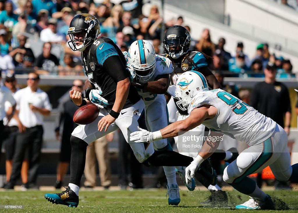 <a gi-track='captionPersonalityLinkClicked' href=/galleries/search?phrase=Blake+Bortles&family=editorial&specificpeople=9706465 ng-click='$event.stopPropagation()'>Blake Bortles</a> #5 of the Jacksonville Jaguars is stripped of the ball by <a gi-track='captionPersonalityLinkClicked' href=/galleries/search?phrase=Jelani+Jenkins&family=editorial&specificpeople=5653455 ng-click='$event.stopPropagation()'>Jelani Jenkins</a> #53 of the Miami Dolphins during the second quarter of the game at EverBank Field on October 26, 2014 in Jacksonville, Florida.
