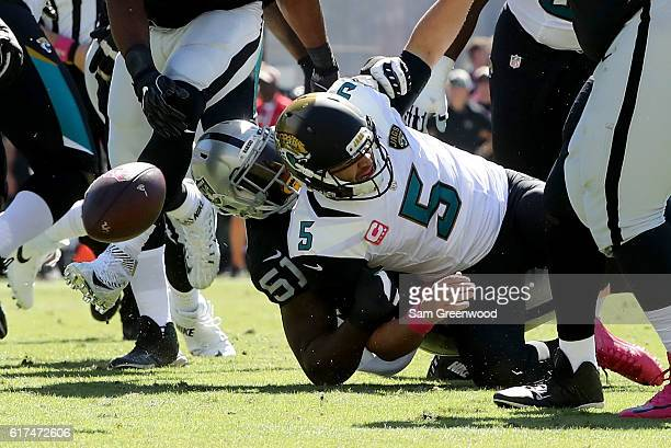 Blake Bortles of the Jacksonville Jaguars is tackled by Bruce Irvin of the Oakland Raiders during the game at EverBank Field on October 23 2016 in...