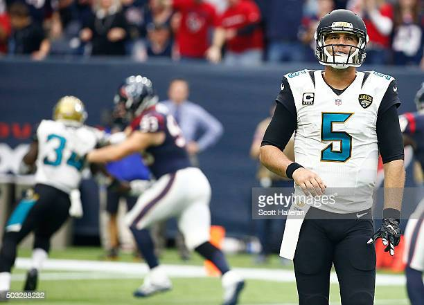 Blake Bortles of the Jacksonville Jaguars reacts after throwing an interception for a touchdown against the Houston Texans on January 3 2016 at NRG...