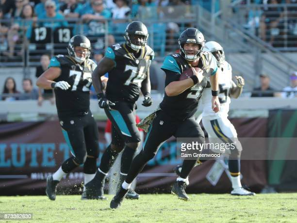 Blake Bortles of the Jacksonville Jaguars runs with the football in the second half of their game against the Los Angeles Chargers at EverBank Field...