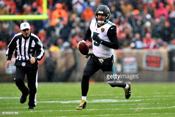 Blake Bortles of the Jacksonville Jaguars scrambles out of the pocket in the first half against the Cleveland Browns at FirstEnergy Stadium on...