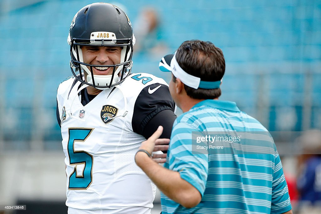 Blake Bortles #5 of the Jacksonville Jaguars speaks with offensive coordinator Jedd Fisch prior to a preseason game against the Tampa Bay Buccaneers at EverBank Field on August 8, 2014 in Jacksonville, Florida.