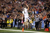 Blake Bortles of the UCF Knights scores a fourth quarter touchdown against the Baylor Bears during the Tostitos Fiesta Bowl at University of Phoenix...