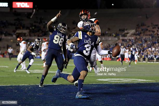 Blake Brandel of the Oregon State Beavers is unable turnover catch Randall Goforth after he returned an interception for a touchdown as Takkarist...