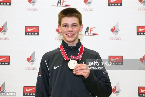 Blake Broszus poses with his gold medal won during the Junior Men's Foil event on April 21 2017 at the Canadian National Fencing Championships at the...
