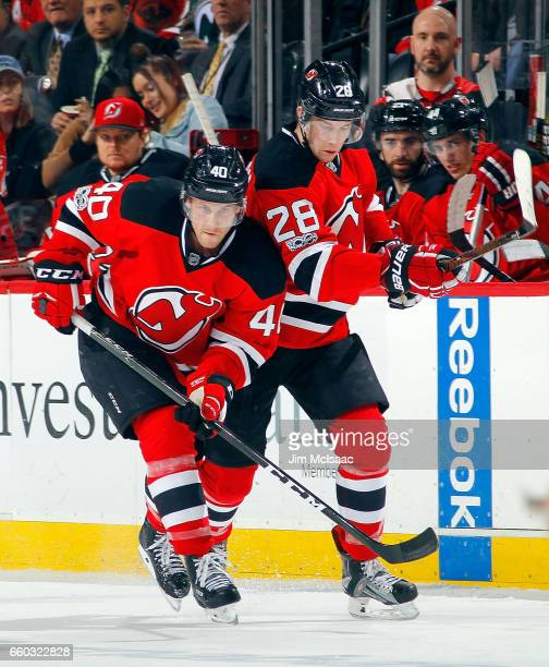 Blake Coleman and Damon Severson of the New Jersey Devils in action against the Dallas Stars on March 26 2017 at Prudential Center in Newark New...