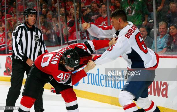 Blake Coleman of the New Jersey Devils and Andre Burakovsky of the Washington Capitals fight during the game at Prudential Center on October 13 2017...