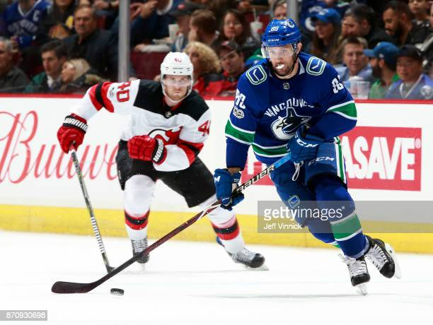 Blake Coleman of the New Jersey Devils and Sam Gagner of the Vancouver Canucks skate after the puck during their NHL game at Rogers Arena November 1...