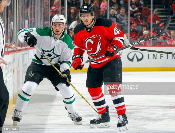 Blake Coleman of the New Jersey Devils in action against Remi Elie of the Dallas Stars on March 26 2017 at Prudential Center in Newark New Jersey The...