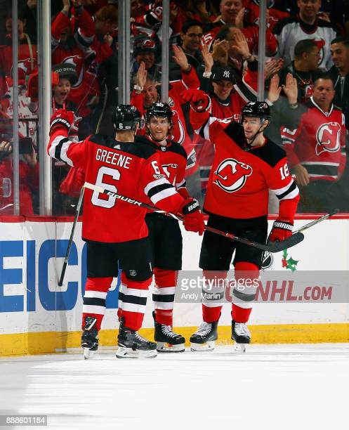 Blake Coleman of the New Jersey Devils is congratulated by his teammates after scoring a secondperiod goal against the Columbus Blue Jackets during...