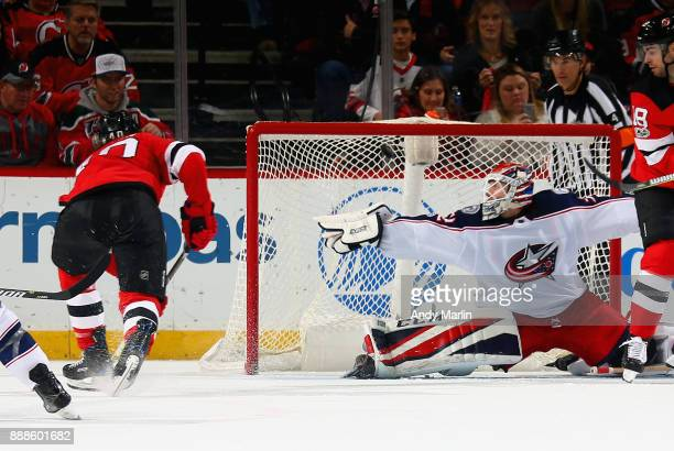 Blake Coleman of the New Jersey Devils puts the puck past Sergei Bobrovsky of the Columbus Blue Jacket for a secondperiod goal during the game at...