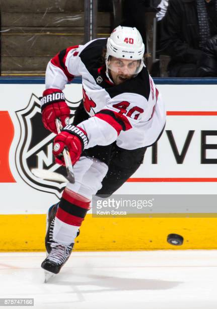 Blake Coleman of the New Jersey Devils takes a shot against the Toronto Maple Leafs during the third period at the Air Canada Centre on November 16...