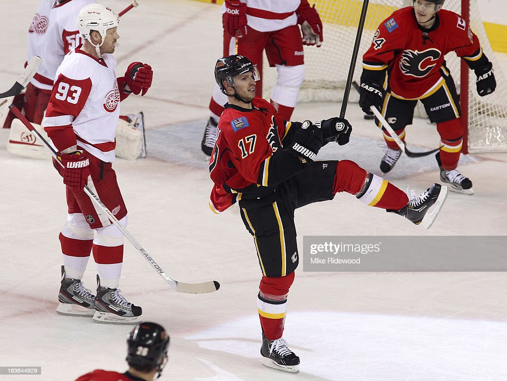 <a gi-track='captionPersonalityLinkClicked' href=/galleries/search?phrase=Blake+Comeau&family=editorial&specificpeople=879782 ng-click='$event.stopPropagation()'>Blake Comeau</a> #17 of the Calgary Flames celebrates his goal beside <a gi-track='captionPersonalityLinkClicked' href=/galleries/search?phrase=Johan+Franzen&family=editorial&specificpeople=624356 ng-click='$event.stopPropagation()'>Johan Franzen</a> #93 the Detroit Red Wings during third period NHL action on March 13, 2013 at the Scotiabank Saddledome in Calgary, Alberta, Canada. Calgary Flames defeated the Detroit Red Wings 5 - 2.