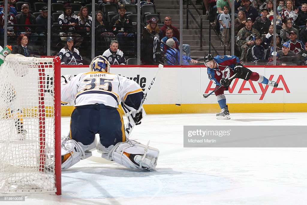 Blake Comeau of the Colorado Avalanche takes a shot against Goaltender Pekka Rinne of the Nashville Predators at the Pepsi Center on March 05 2016 in...