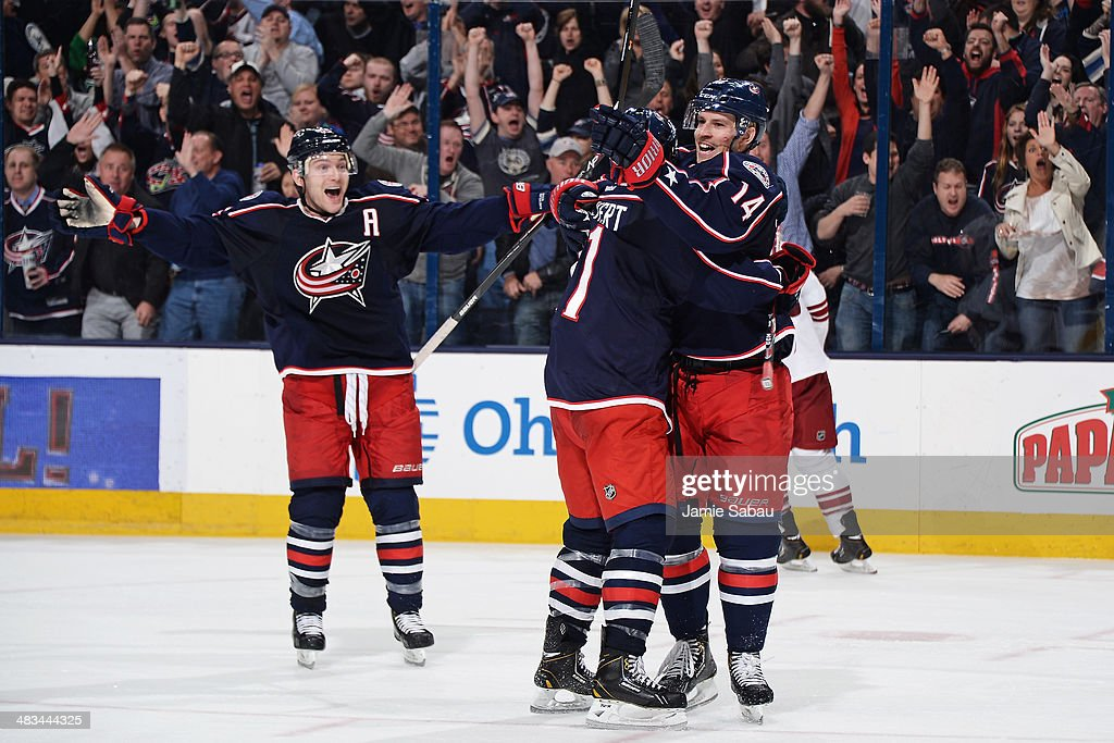 <a gi-track='captionPersonalityLinkClicked' href=/galleries/search?phrase=Blake+Comeau&family=editorial&specificpeople=879782 ng-click='$event.stopPropagation()'>Blake Comeau</a> #14 of the Columbus Blue Jackets celebrates his third-period goal with teammates Matt Calvert #11 and <a gi-track='captionPersonalityLinkClicked' href=/galleries/search?phrase=Mark+Letestu&family=editorial&specificpeople=4601071 ng-click='$event.stopPropagation()'>Mark Letestu</a> #55 during a game against the Phoenix Coyotes on April 8, 2014 at Nationwide Arena in Columbus, Ohio. Columbus defeated Phoenix 4-3 in overtime.